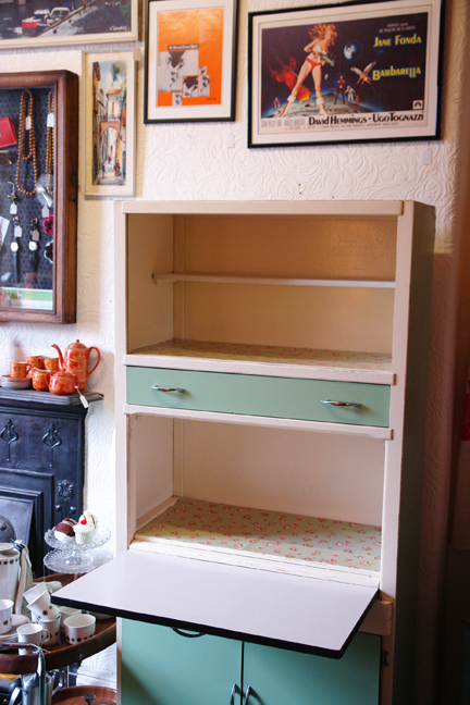 view of fully renovated 1960s wood & Formica kitchen cabinet when empty