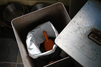 vintage aluminium Grundy bin containing a large bag of dog food