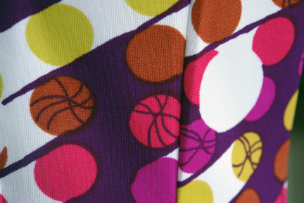 detail of fabric from vintage 1960s/70s sleeveless patterned polyester dress