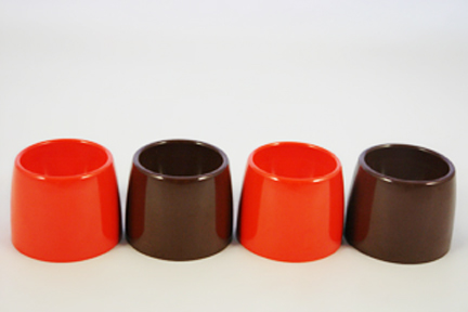 set of vintage orange and brown melamine egg cups