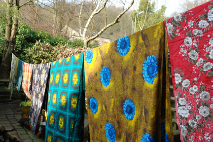 collection of vintage 1950s fabric hanging on a washing line