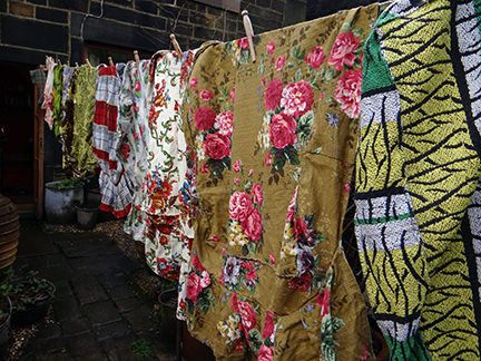 collection of vintage fabric pieces drying on a washing line