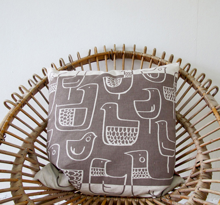 cushion covered in Skinny laMinx 'Eep' fabric sitting on a vintage circular wicker chair