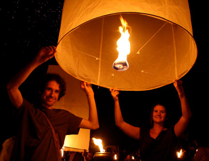 Simon &amp; Erin launching a paper lantern in Yee Peng, Thailand
