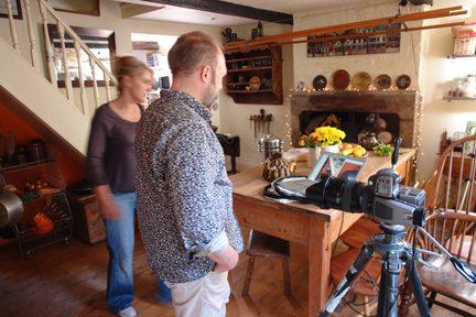 Photographer, Simon Whitmore and stylist, Sally Denning in our kitchen discussing photos