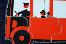 detail of vintage children's jigsaw of a red London double decker bus