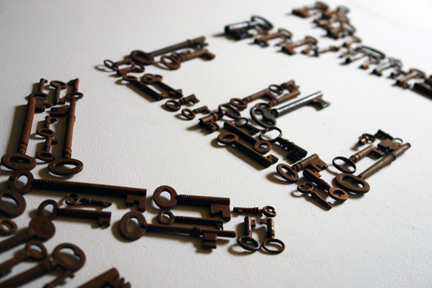 "group of antique keys spelling out the word ""key"""