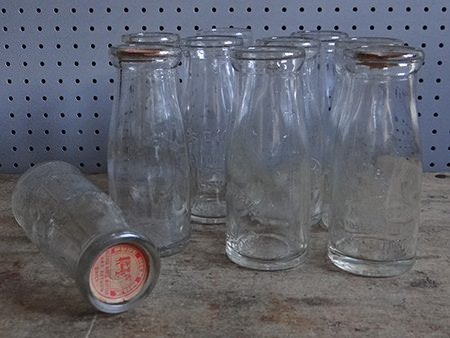 collection of Greater Manchester half pint milk bottles