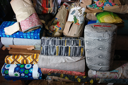 large number of vintage fabric bolts