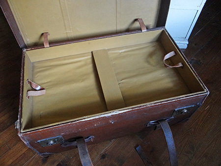 large vintage leather trunk showing interior