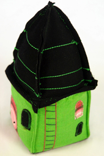 green fabric doorstop / bookend handmade by Sarah Nicol