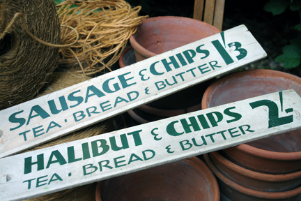 two hand painted wooden fish and chip shop signs from a selection of vintage garden items