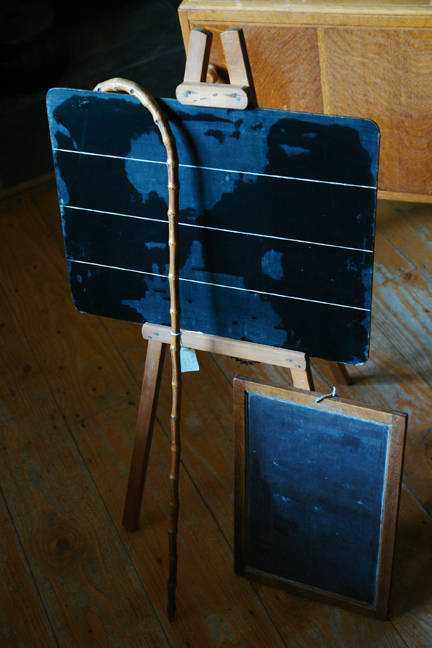vintage writing slate, blackboard on an easel, and bamboo walking cane