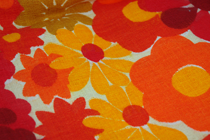close up view of floral patterned fabric in shades of orange