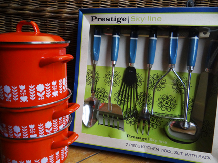 selection of recently acquired vintage homewares including set of 3 orange enamel saucepans and blue boxed set of Prestige cooking utensils