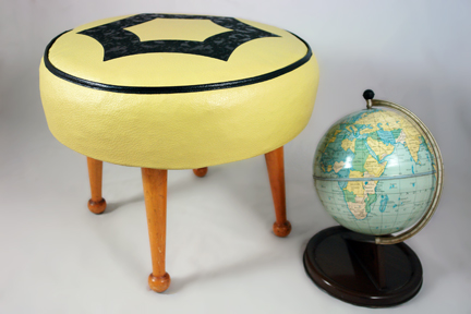 new H is for Home stock items; yellow 1950s leatherette footstool and vintage Chad Valley tin globe