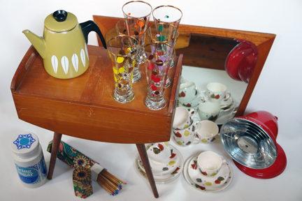"selection of vintage items recently acquired by H is for Home including an olive green Cathrineholm teapot, Lord Nelson pottery icing sugar canister, 1950s patterned pilsner glasses, beechwood sewing box, fire lighting matches with colourful tips in original hexagonal shaped, cardboard box, bright red metallic Barber Polykymatic heat generator, Danish teak framed mirror and set of Alfred Meakin ""Gay Fantasy"" tea trios"