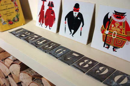 vintage metal number stencils on a shelf