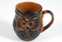 vintage pottery mug with owl face in relief on the side
