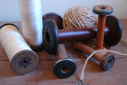 collection of wooden antique cotton reels