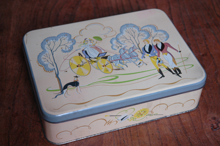 vintage biscuit tin produced by A Romary and Company Limited decorated with Regency period figures of dandies promenading and ladies in a horse drawn carriage