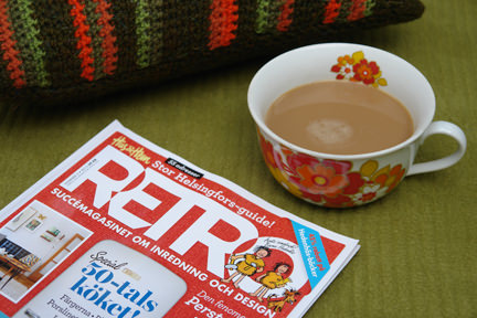 Retro Magazine with cup of tea and green & orange striped knitted cushion