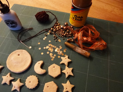 cooked salt dough cut out shapes with craft materials