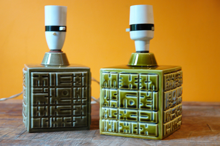 pair of small, olive green, cube-shaped vintage Poole Pottery lamp bases with geometric pattern decoration