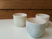 a trio of small ceramic pots by Ikuko Iwamoto available at Snug Gallery in Hebden Bridge