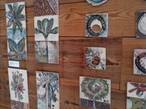 range of ceramic tiles decorated with nature motifs made by Linzi Ramsden and available at Snug Gallery in Hebden Bridge