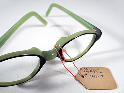 pair of vintage green 1950s spectacle frames
