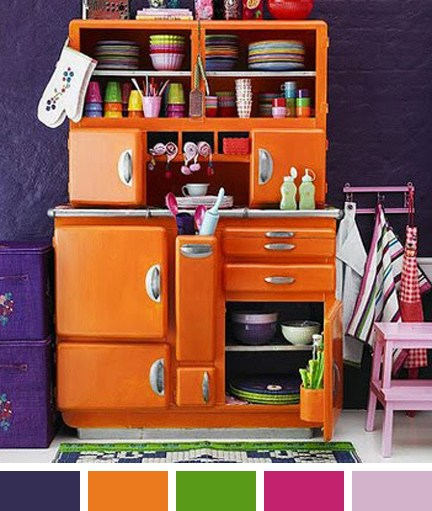 orange vintage 1950s/60s  kitchenette against a purple wall