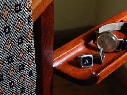 detail from vintage valet stand showing vintage 'A' cufflinks, Smiths watch and tie