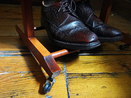 detail from vintage valet stand showing vintage brown leather brogues