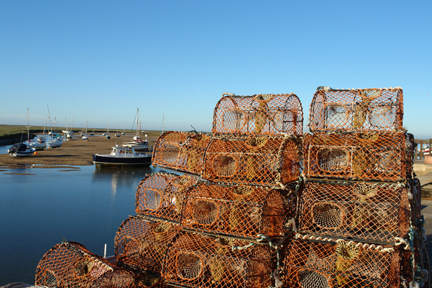 crabpots stacked up in the harbour, Wells-next-the-Sea