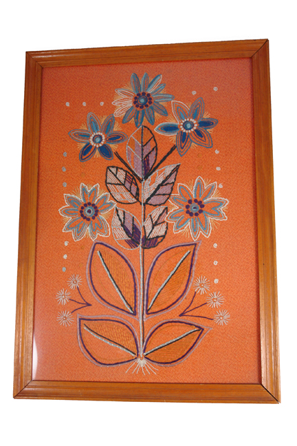 framed & glazed vintage wool work in shades of orange featuring a bouquet of flowers
