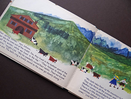 Cows in an alpine scene from the 'Austria' book from the World Dolls Series