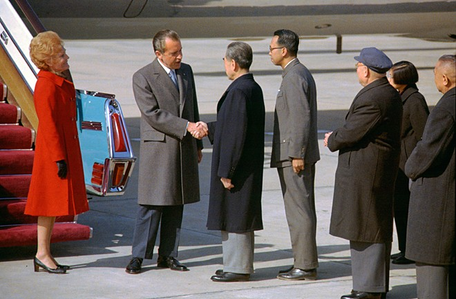 Nixon arrives in Beijing, February 21 1972. Here he is shaking hands with Zhou En-lai.