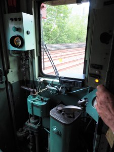 Inside the drivers cabin of the red rattler