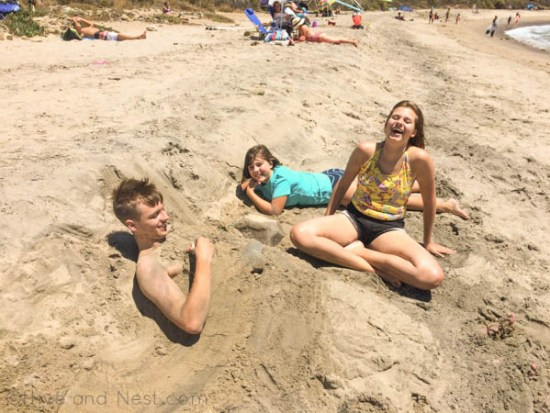 kids laughing buried sand