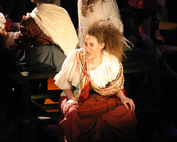 Madame Thénardier (Holly Longmore) sings to young Cosette