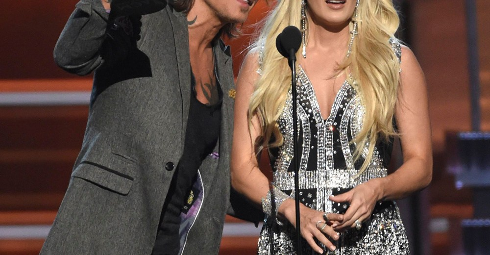 """Mandatory Credit: Photo by Chris Pizzello/Invision/AP/REX/Shutterstock (9630041ct) Keith Urban, Carrie Underwood. Keith Urban, left, and Carrie Underwood accept the award for vocal event of the year for """"The Fighter"""" at the 53rd annual Academy of Country Music Awards at the MGM Grand Garden Arena, in Las Vegas 53rd Annual Academy Of Country Music Awards - Show, Las Vegas, USA - 15 Apr 2018"""