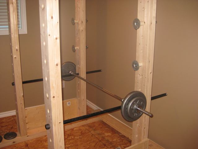 Homemade Power Rack Made Out Of Wood And Pipe
