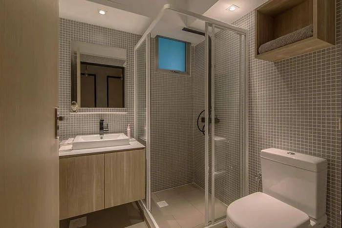This bathroom is finished extensively in concrete screed while the