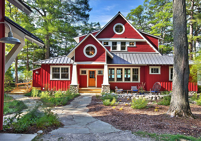 Rustic Cottage With Red Trim Windows And Dark Wood Rustic Siding