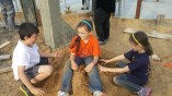 Playing with cousins on our sandy site