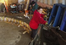 Sherri pulling down the last bits of concrete from the chute