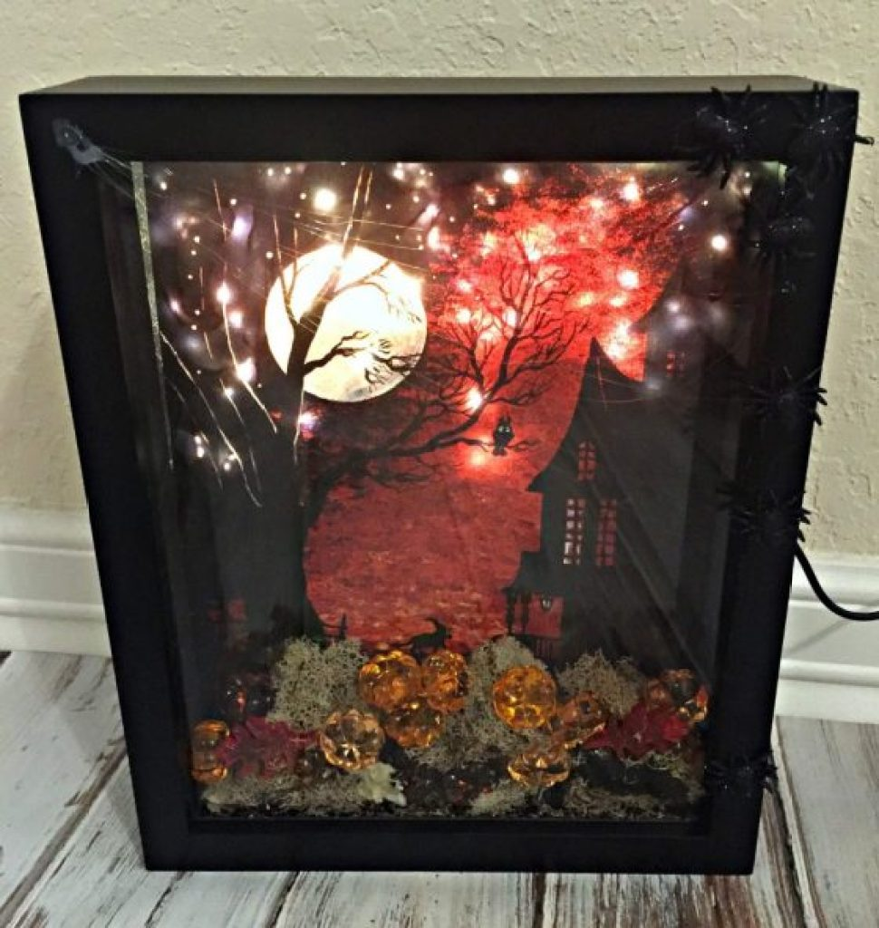 Create a luminous halloween scene with this diy shadow box for Diy shadow box table