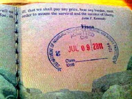 Visa stamp in a passport to Italy