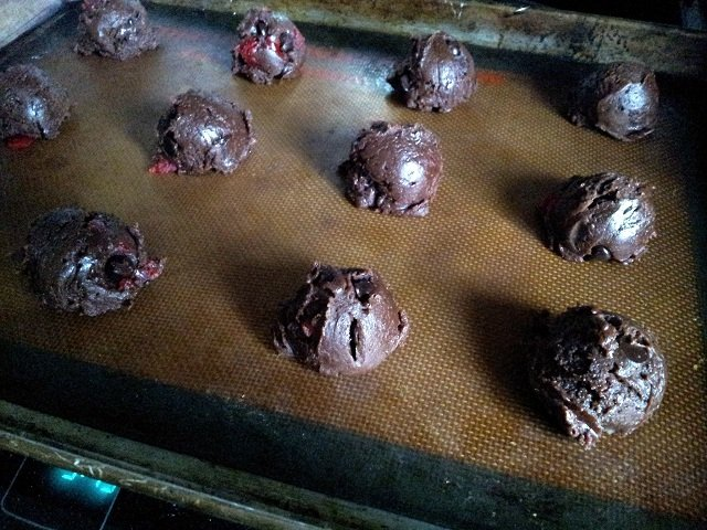Double Chocolate Chunk Cherry Cookies spaced on a tray for baking